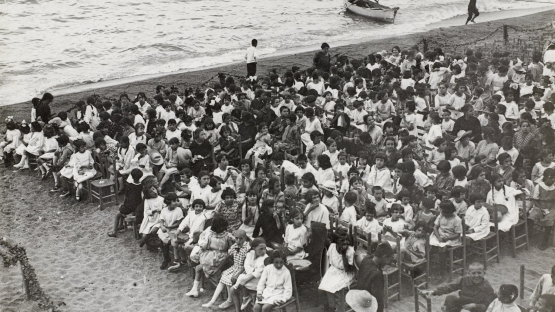 Photograph of ta festive function on the beach, Escola del Mar.