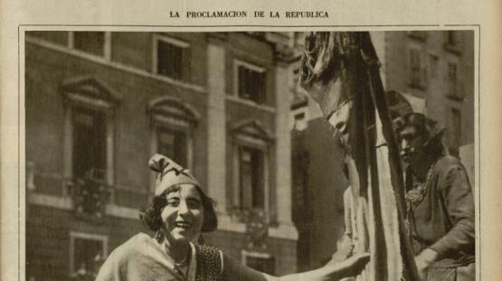 Portada de La Vanguardia de 17.4.2017 amb la fotografia d'una noia amb barret frigi passejant amb la bandera republicana, per la plaça de Sant Jaume.
