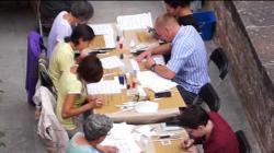 Video del taller de cal.ligrafia històrica i caplletres