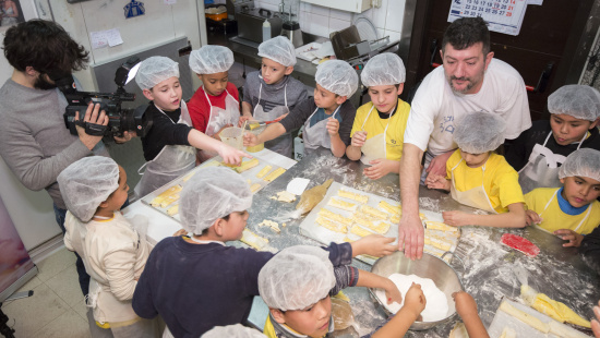 Barcelona's school children participate in a visit to Lliso Lis bakery