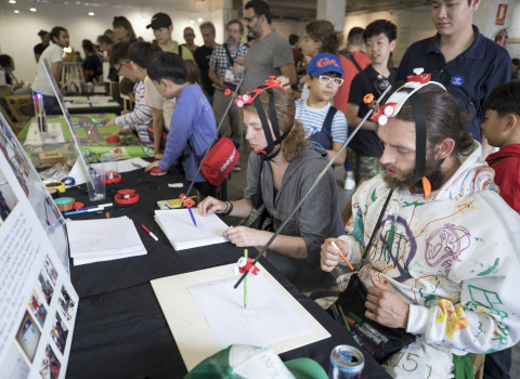 Visitors experimenting at the stands of the Maker Faire Barcelona 2019.