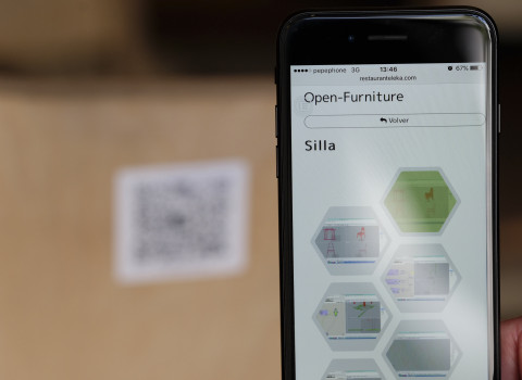 "Download of the ""open source"" furniture from a restaurant with a cell phone."