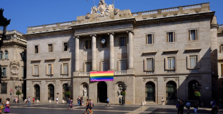 Facade of the Barcelona City Hall with a flag of gay pride