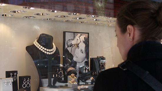 girl looking at a jewellery display