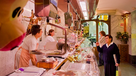 customers shopping at a butcher's
